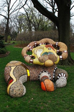 Whimsical Lion sculpture by Niki de Saint Phalle at the Missouri Botanical Garden in St. Louis; over 7 feet tall and weights 3,000 pounds; completed in 2000 - photo by Jennifer Meinhardt