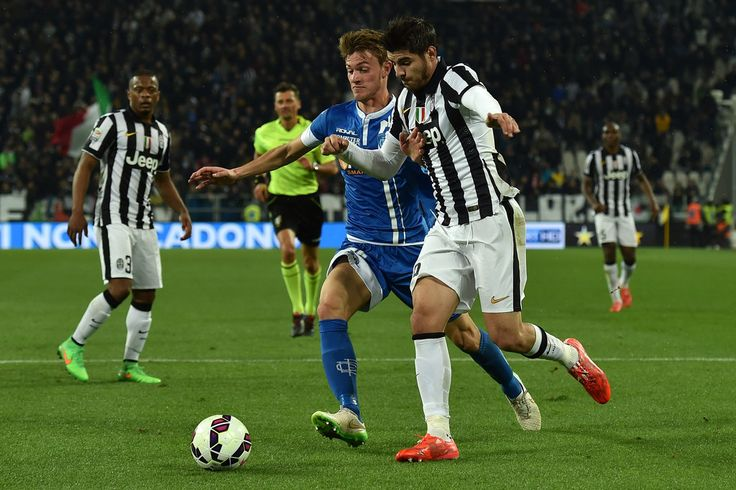 Alvaro Morata (R) of Juventus FC is challenged by Daniele Rugani of Empoli FC during the Serie A match between Juventus FC and Empoli FC at Juventus Arena on April 4, 2015 in Turin, Italy.