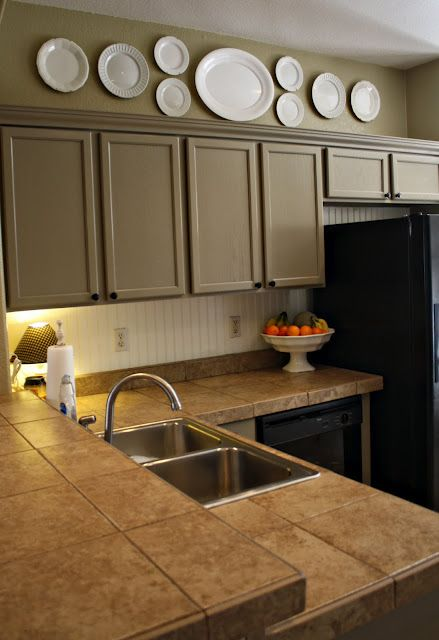 Oak Kitchen Cabinets, Painted Earthy Stoneware by Better Homes and Garden to make them more contemporary.
