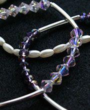 JARDÍN DE HADAS: Pulsera triple en murano violeta y preciosa rosa ligth, con separadores plateados y cuentas color perla.