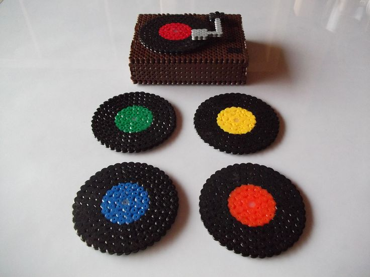 Perfect to save your table from damage, this Flame set of coasters with its own Fireplace stand will add a bit of originality to your home.  Made of fuse beads, each coaster is 7.5 x 7.5 cm and this set includes four.  Colours can be changed to suit your taste.  The stand where you keep the c...
