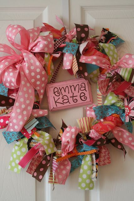 cute fabric wreath. Use a thicker wire and make it into a flower or even a letter for the door or wall....just tear the fabric into strips to get that frayed look and use the pinks she likes and black and zebra fabrics.....could be super cute!!