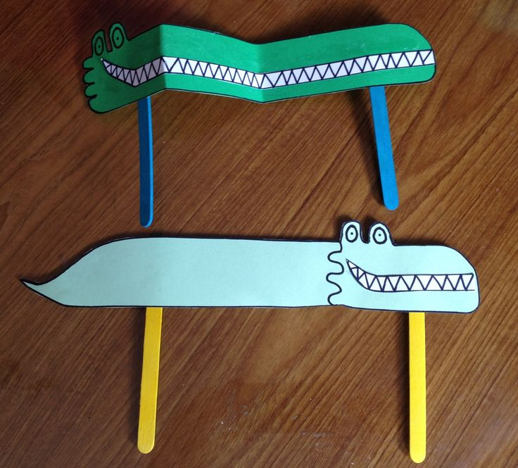 The Enormous Crocodile from Roald Dahl's famous book. Make template out of green card and template of teeth on white card then stick on to the green template the teeth and wobbly eyes. Attach lollipop sticks and......sorted Xx