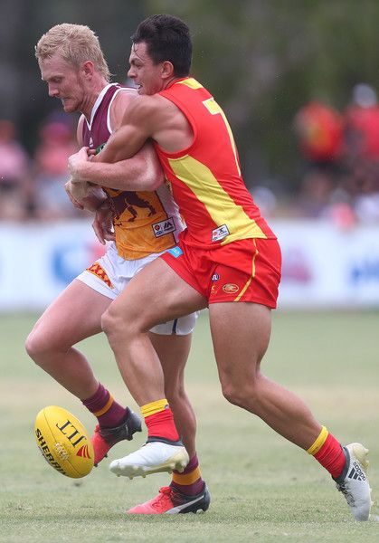 Nick Robertson of the Lions is tackled by Jesse Lonergan of the Suns during the 2017 JLT Community Series match at Broadbeach Sports Centre on February 19, 2017 in Gold Coast, Australia.