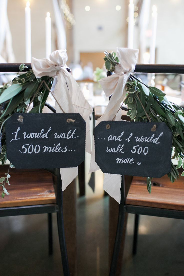 Cute signs on chairs for the bride and groom!