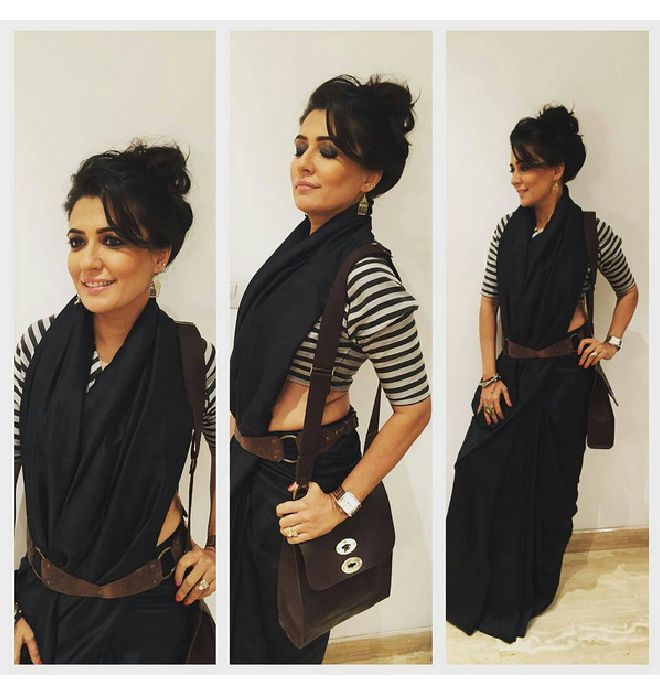 Mini Mathur draped a black Raw Mango saree with a modern twist at the annual Vogues 'Fashions Night Out over the weekend.: