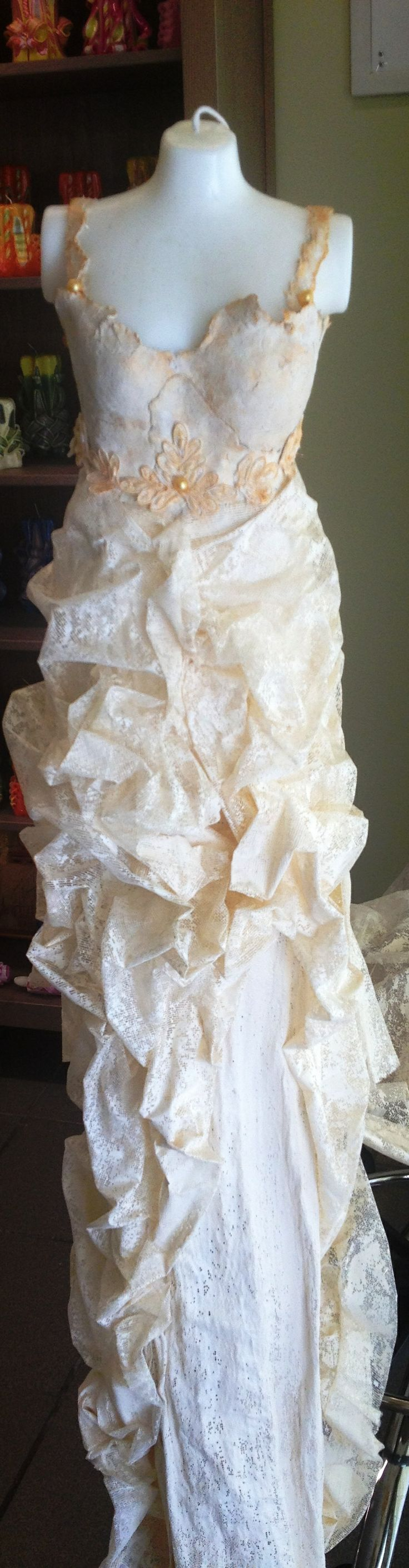 A candle as a wedding decor, with tuille, lace with pearls  and stone art.
