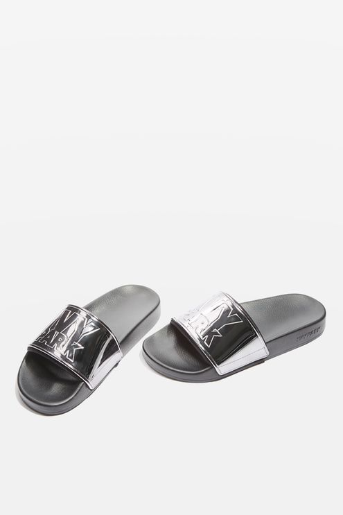 Metallic Ivy Park sliders with neoprene sock for added comfort. By Ivy Park.