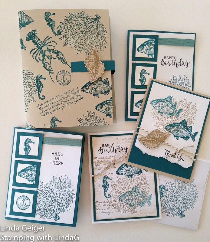 """Image of a box, four cards, and an envelope, stamped with Stampin' Up! Stamp Set """"By the Tide."""" Colors are island indigo and crumb cake."""