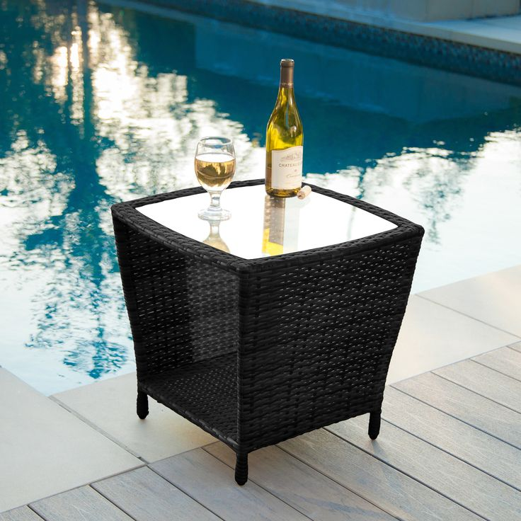 The Weston wicker outdoor side table is stylish and convenient for your outdoor needs. You can place this table near your seating area to serve snacks and beverages on top of the glass table top.