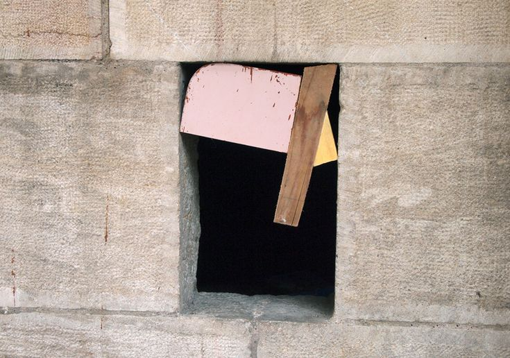 Two artists install bits of found wood with a hand saw and rubber mallet, into 52 cellar door and window spaces particular to Besançon, France. artists: MOMO + El Tono location: Bensacon, France