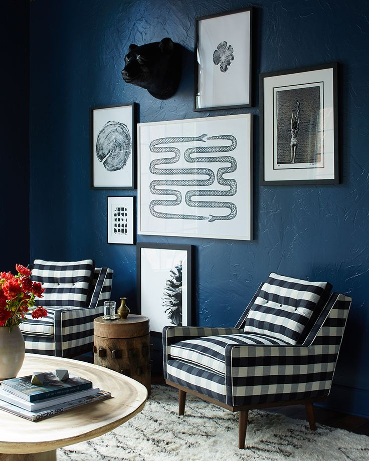 black & white on blue gallery wall, modern rustic