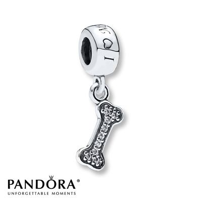 "A dog bone decked in clear cubic zirconias dangles from a sterling silver charm inscribed with ""I Love My Dog"" in this charm from the Pandora Spring 2014 collection. Style # 791263CZ."