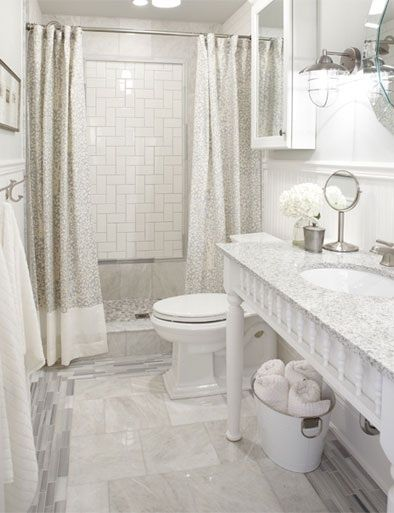 Walk-in tiled standing shower with two shower curtains instead of glass wall or glass
