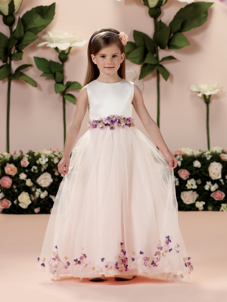 Sleeveless satin, tulle, taffeta and organza full-length A-line dress with satin bodice, hand-beaded three-dimensional taffeta and organza flowered waistband with taffeta tie back sash, taffeta skirt with double layer tulle overlay featuring matching flowers at hemline and on sweep train, suitable as a flower girl dress or girls party dress. Coordinates with fancy baby dress [...]
