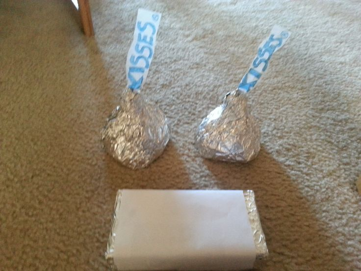 Simple Instructions : Hershey Kisses - I used clean two liter soda bottles that I cut the tops off (without lids).Then I firmly tapped a piece of construction paper to the bottom.  You can probably use a plastic lid too. Then covered with alluminum foil and I used tissue paper for the tag part.......Chocolate Bar - I used clean pasta/cereal boxes and wrapped ends with foil and middle with plain white paper.... I made these for my daughters 2nd Candyland Birthday Party 2013