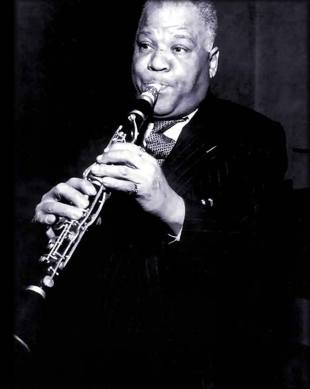 Sidney Bechet [1897, New Orleans, LA - 1959, Garches, France] was a jazz saxophonist, clarinetist, and composer. He was one of the first important soloists in jazz (beating cornetist and trumpeter Louis Armstrong to the recording studio by several months and later playing duets with Armstrong), and was perhaps the first notable jazz saxophonist. Forceful delivery, well-constructed improvisations, and a distinctive, wide vibrato characterized Bechet's playing.