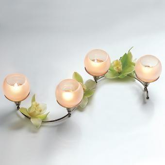 Quartet Centerpiece with tealight globes creates a beautiful glow!