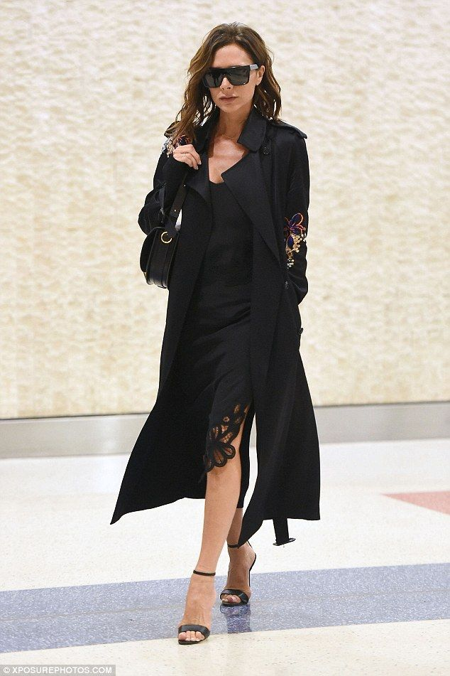 Stylish: Victoria flaunted her toned pins in a daring thigh-high cut black slip dress while in JFK airport earlier on Friday