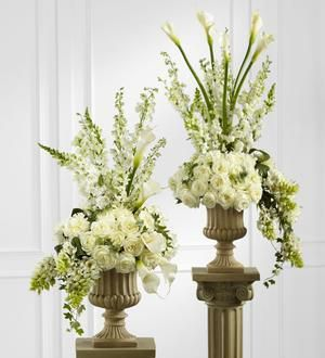 White Floral Church Arrangement: Altar arrangements in white---another option of floral for church altar