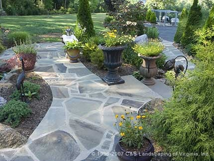 Irregular flagstone patio and plantings - www.cslandscaping.com