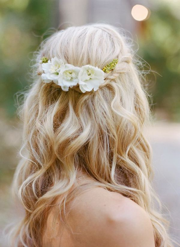 i like the idea of it just different flowers  Loose Waves Wedding Hair | Wedding Hairstyles: 15 Fab Ways to Wear Flowers in Your Hair