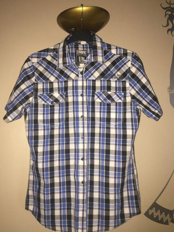 Chemise bleu à carreaux blancs et noirs OWK manches courtes - vinted.fr