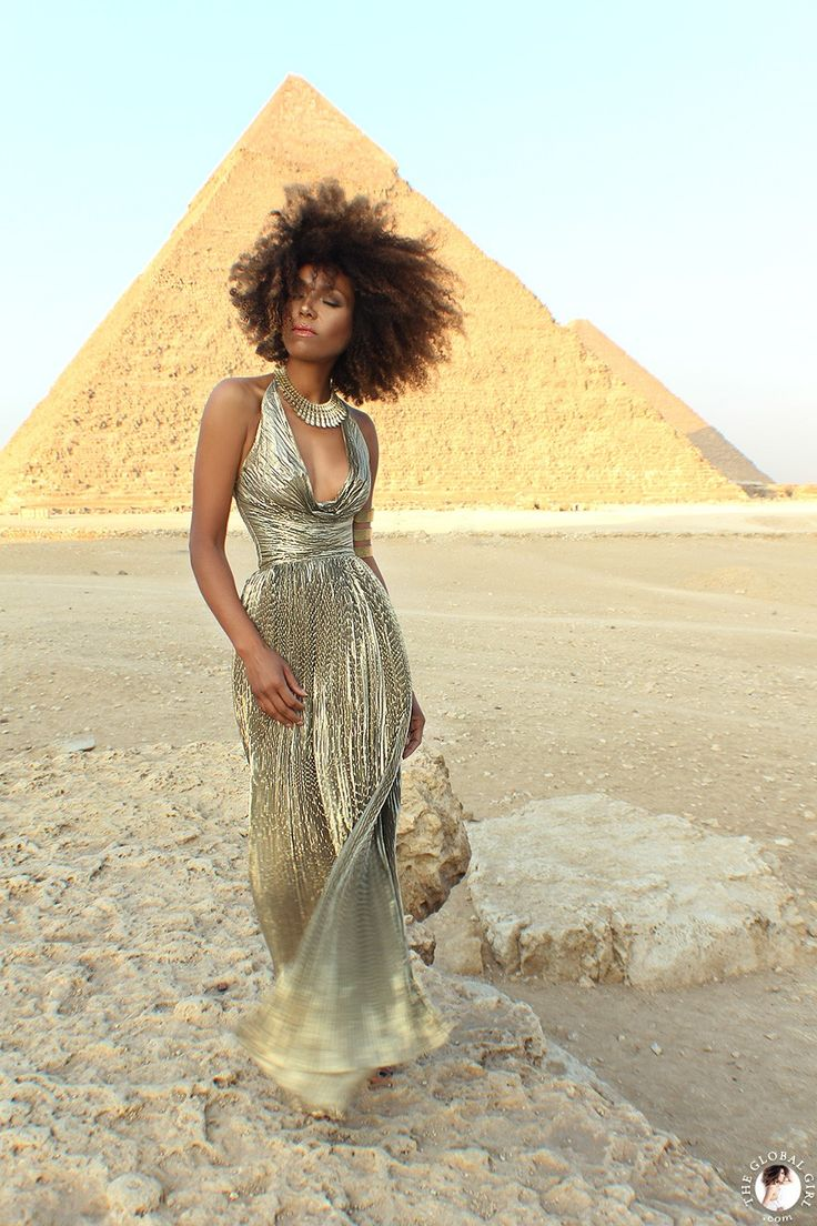 The Global Girl Fashion Editorials: Ndoema in a goddess gold lame gown by Vicky Tiel at the Giza Pyramids in Egypt.