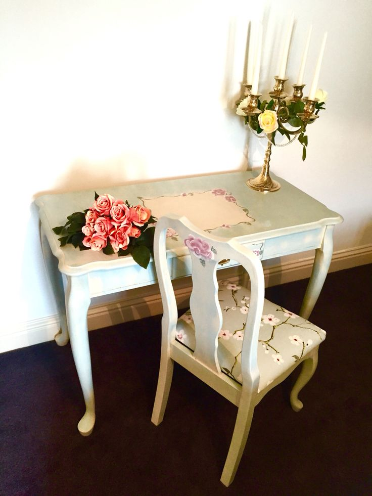 Shabby chic hall table and chair. Painted in general finishes cream and a mix of authentico and colortrend to make the blue. Hand painted flowers.