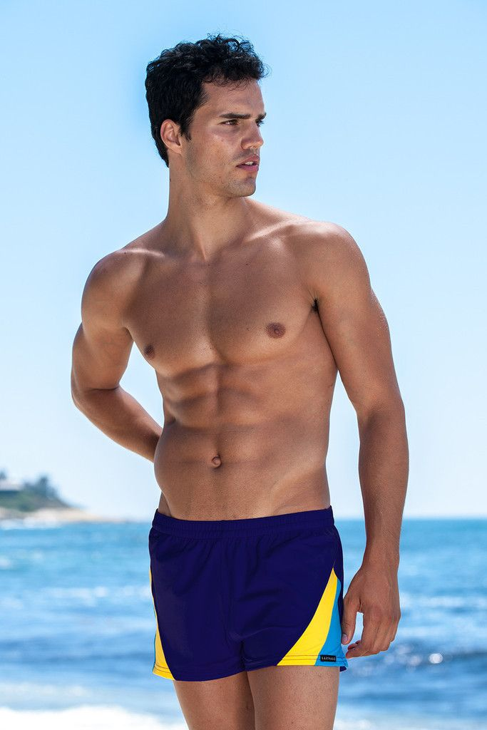 Sauvage Swimwear Swim Trunks - Navy. As classic as they come. For any age or body type this 80's-inspired swimmer will fit (due to an adjustable waistband) and feel divine (due to the super-soft Lyrca fabric adored by Sauvage Swimwear and you).  Take a dive in the deep blue sea in these navy (aka deep blue) bottoms. This pair of men's swim trunks is charged with a masculine and sporty vibe, perfect for water polo, beach volleyball or just pool laps.#navyswimtrunks
