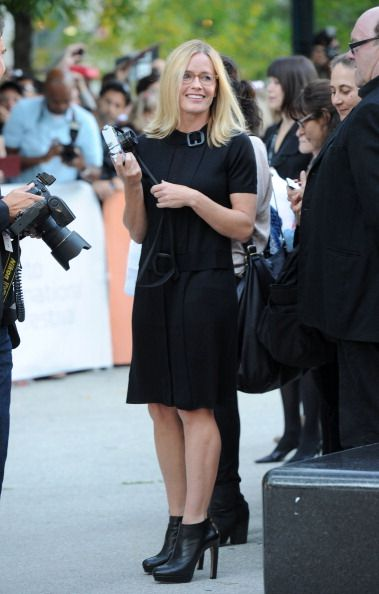 Actress Elisabeth Shue holds a camera as she arrives at 'From The Sky Down' Premiere at Roy Thomson Hall during the 2011 Toronto International Film...