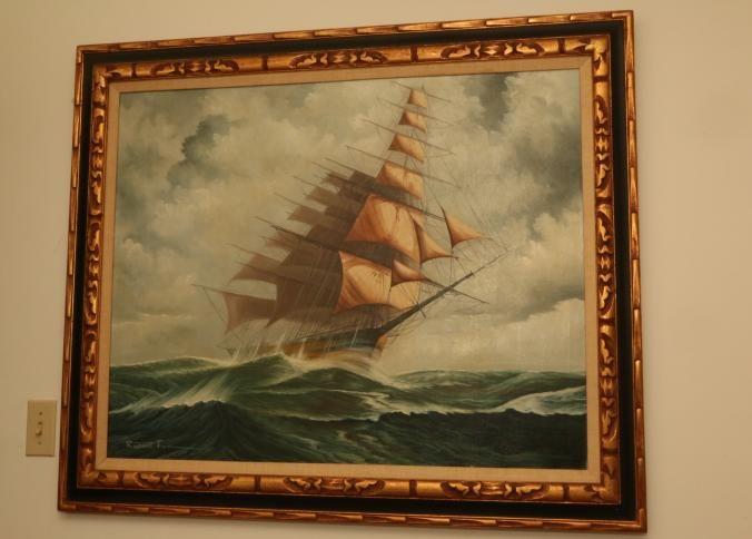 "Oil on canvas of a sailboat on the open water signed lower left Robert Fox, in a carved gilt frame 48""x38""T."