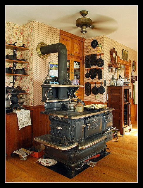 hotographed on a farm west of Lansing in south-central Michigan. The farmhouse is full of antiques, including this substantial wood stove. The stove carries a 1909 patent. At the right-hand side of the stove is a gas fired oven and double burner attachment.
