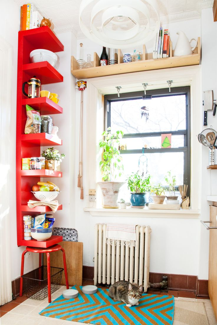 Inside the bright and cheery home of @Refinery29's editor in chief, Christene Barberich there is open shelving, potted plants and vintage iron heater. Click through for more photos of this adorable home.
