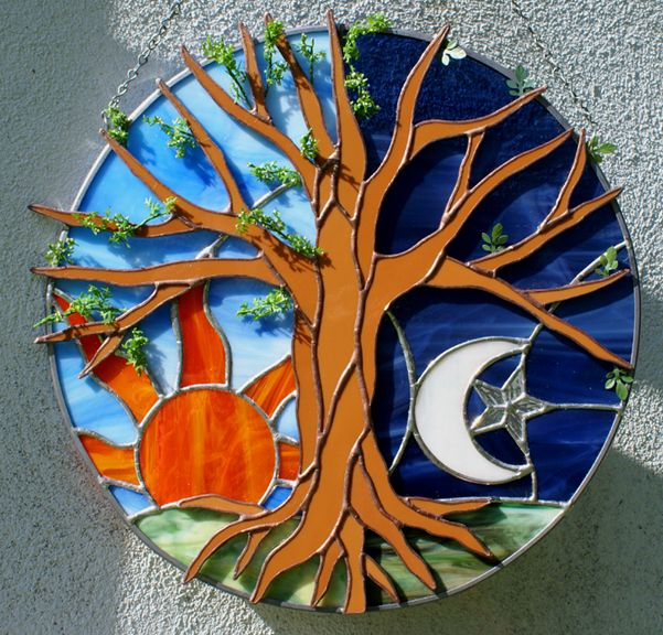 Earth, Tree, Sea and Sky in Stained Glass from a Touch of Glass... http://www.atouchofglassand.com/landsea.html
