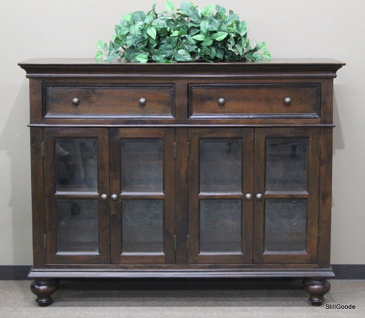 Tall dark wood sideboard or media cabinet with 2 drawers, 4 beveled glass doors, interior shelf. #OnTheShowroomFloor #Tall #Dark #Wood #Media #Sideboard #Cabinet #StillGoode