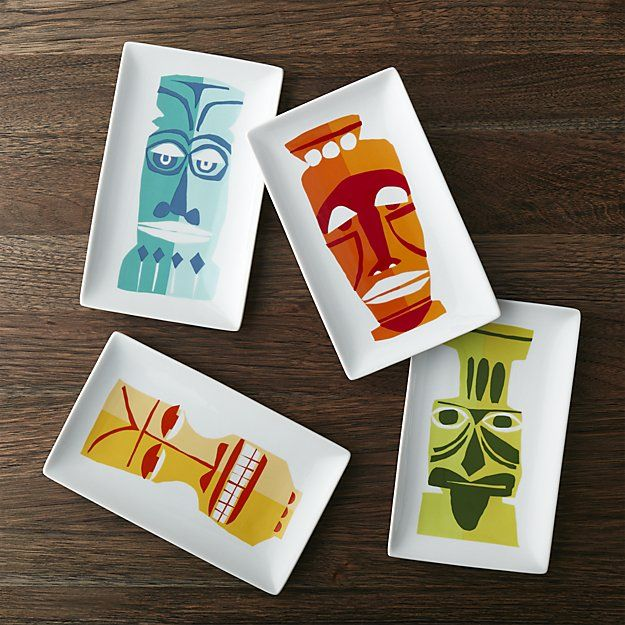 Let your guests know it's tiki time with these tropics-inspired appetizer plates designed by Jane Dixon. Each rectangular white porcelain plate features its own whimsical Polynesian mask, graphically rendered in tonal brights. Four coordinating snack/appetizer plates are tied with raffia for a convenient, colorful hostess gift.