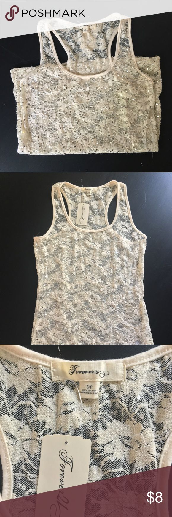Sheer lace razorback tank with silver sequin Sheer lace razorback tank with silver sequin. Size Small. New with tags Forever 21 Tops Tank Tops