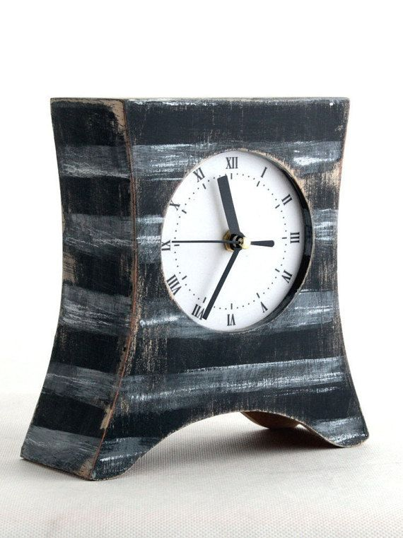 White stripes clock, Wood Table clock, Mantel clock, This Desk Clock in vintage style is made solid wood and plywood. Free shipping unique gift will be perfect for anyone on any occasion like Xmas or Black Friday sale. Wood Clock is handmade and handpainted and Black & white are dominant color. This Black Table Clock is protected ecological varnish. Great gift ideas in vintage style, Rustic Mantle decor and usefull everyday.  DIMENSIONS: HEIGHT, WIDTH, DEPTH /18,5 cm x 17 cm x 9,5 cm. /7,3 x…