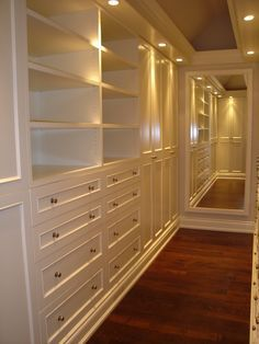 Great for a master closet: shelving and drawers on one side, open rods on the other for hanging, and the perfect-sized mirror at the back to model before stepping out