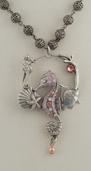 "Seahorse Hoop Necklace made with shades of vintage rose and white opal Swarovski Crystals, and cabochons in pink mussel and mabe pearl. 18"" long. Made with American Lead Free Pewter. Please allow 2-4"