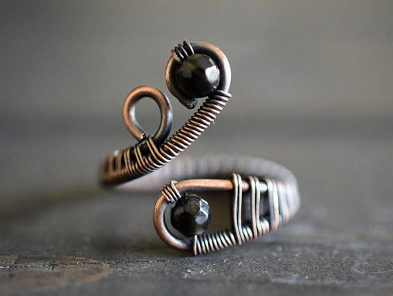 This beautiful genuine gemstone ring features black Obsidian Gemstones and a unique wire woven design. This ring comes in timeless bare copper style, or a beautiful oxidized copper patina. Each piece is custom made to fit you perfectly! The open structure of this ring allows you to