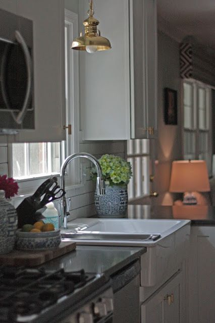 brass pendant, window coverings - david hicks - farmhouse sink - looks inviting! the little black door: make new friends but keep the old