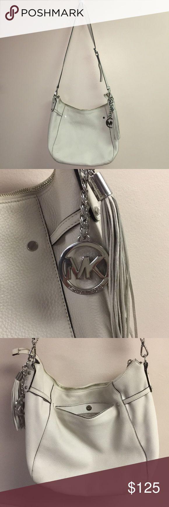 Michael Kors purse Authentic MK Megan vanilla leather & silver shoulder bag. Adjustable strap. Gently used. Michael Kors Bags Shoulder Bags