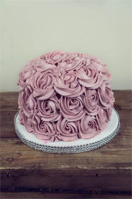 Single tiered wedding cake covered in lilac buttercream roses