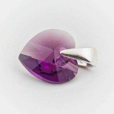 Swarovski Heart Pendant 10mm Amethyst  Dimensions: length: 1,4cm stone size: 10mm Weight ~ 0,72g ( 1 piece ) Metal : sterling silver ( AG-925) Stones: Swarovski Elements 6228 10mm Colour: Amethyst 1 package = 1 piece Price 5.49 PLN