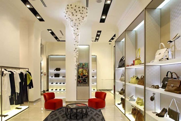 This boutique is set up in a similar way as my vision for the store. I love the track lighting on the ceiling that adds a spotlight to the merchandise. I also love the light hardwood floors and white walls. The shelving unit containing purses and shoes is also visually appealing and an interesting way to showcase the merchandise. Finally, I like the pop of color from the chairs in the middle of the room.