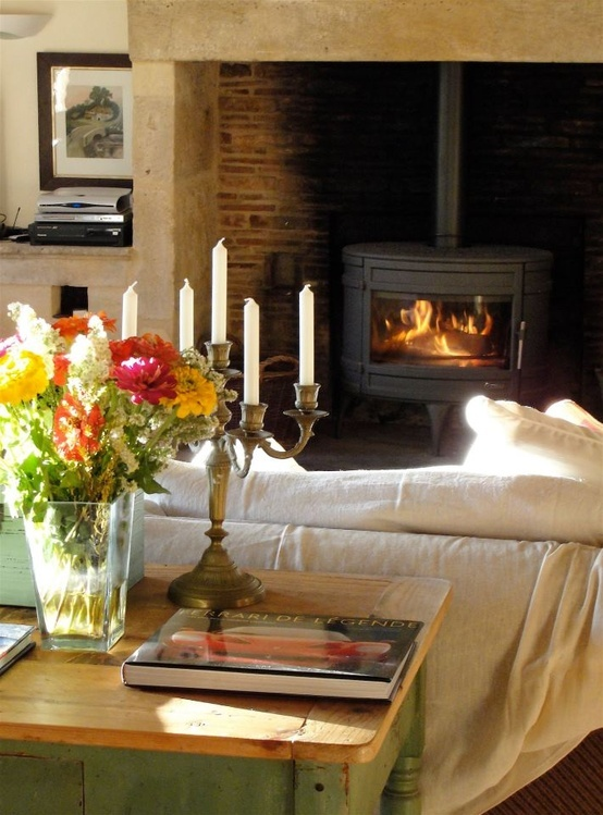 Wood stove inside fireplace as focal point