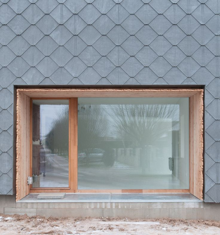French barn conversion covered in cement shingles