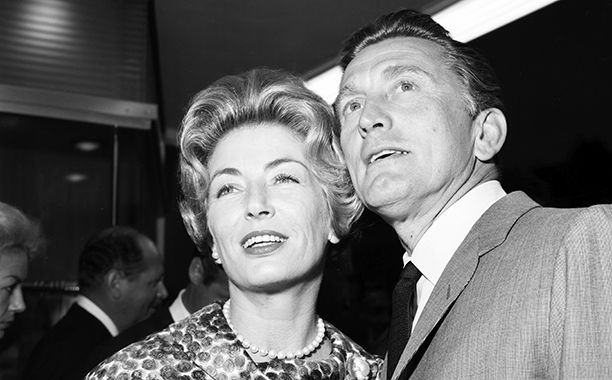 The Evolution of Kirk Douglas | Kirk Douglas With Anne Buydens at a Party in Los Angeles in 1961 | EW.com